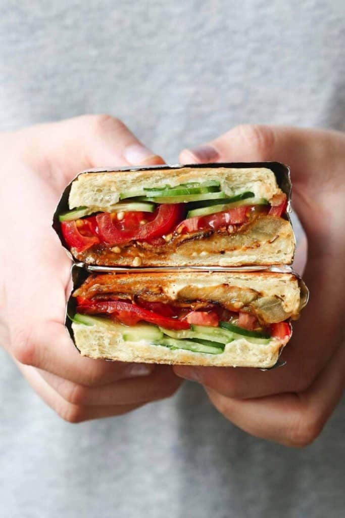 holding open eggplant sandwich, halves stacked on each other