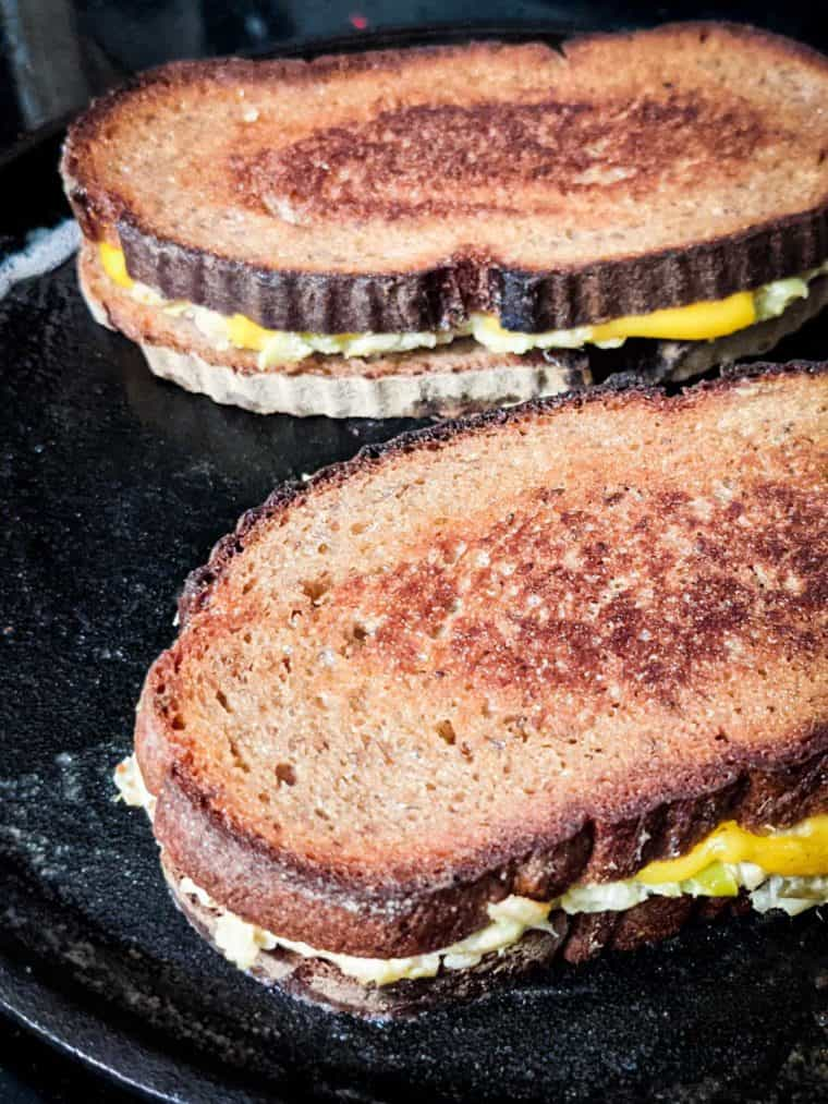 vegan broccoli grilled cheese sandwiches in a pan