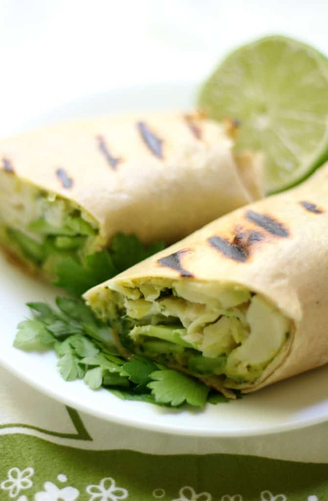 grilled green goddess wrap on a white plate on green and white kitchen towel