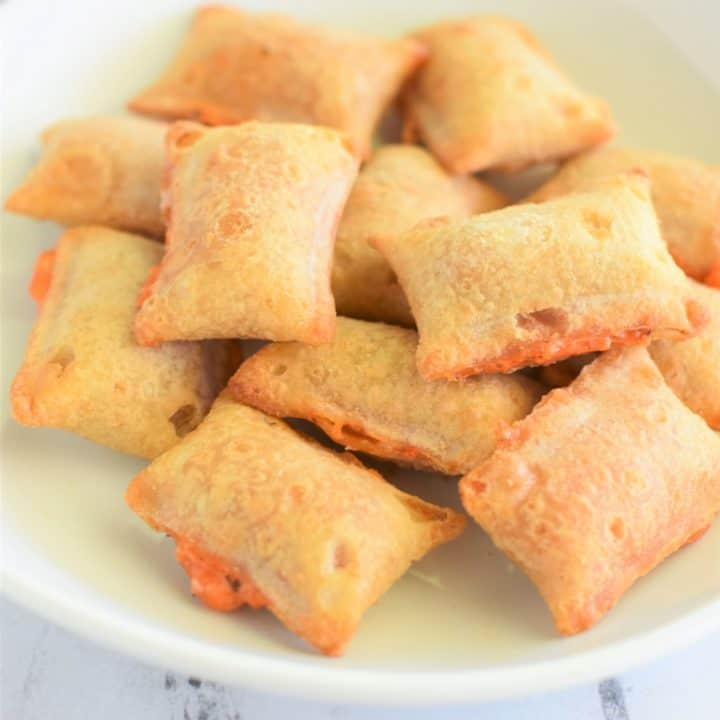close-up of pizza rolls on white plate