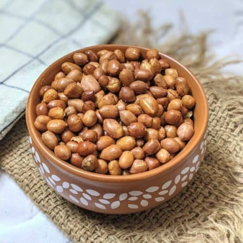 air fried peanuts in brown serving bowl with white designs on it